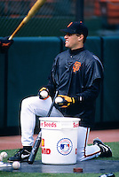 SAN FRANCISCO, CA - J.T. Snow of the San Francisco Giants warms up before a game against the New York Mets at Candlestick Park in San Francisco, CA on April 5, 1997. Photo by Brad Mangin
