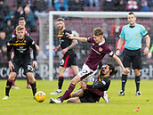 17th March 2018, Tynecastle Park, Edinburgh, Scotland; Scottish Premier League football, Heart of Midlothian versus Partick Thistle;  Ryan Edwards of Partick Thistle slides in on Harry Cochrane of Hearts
