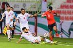 Hwang Heechan of South Korea (R) fights for the ball with Komail Hasan Alaswad of Bahrain (bottom) during the AFC Asian Cup UAE 2019 Round of 16 match between South Korea (KOR) and Bahrain (BHR) at Rashid Stadium on 22 January 2019 in Dubai, United Arab Emirates. Photo by Marcio Rodrigo Machado / Power Sport Images