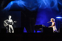 Catherine Major performs by an hologram of Felix Leclerc during the Hommage a Felix Leclerc concert at the Festival d'ete de Quebec on the plains of Abrahams in Quebec City Thursday July 3, 2014.