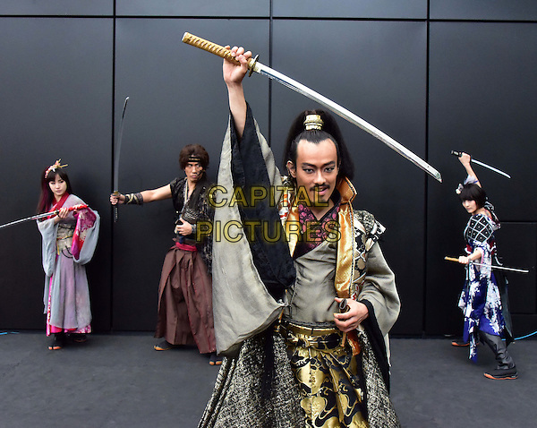 LONDON, ENGLAND - NOVEMBER 19: The Japanese theatre company 30-DELUX present an exclusive samurai swordplay scene from their show Kuli-Kala Revenge of the Samurai at Crossrail Roof Gardens, Canary Wharf. Performances: November 24th-28th at Stratford Circus Arts Centre, London, England.<br /> CAP/JOR<br /> &copy;JOR/Capital Pictures