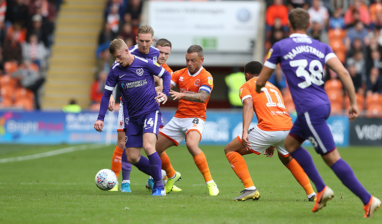 Portsmouth's Andy Cannon shields the ball from Blackpool's Jay Spearing<br /> <br /> Photographer Stephen White/CameraSport<br /> <br /> The EFL Sky Bet League One - Blackpool v Portsmouth - Saturday 31st August 2019 - Bloomfield Road - Blackpool<br /> <br /> World Copyright © 2019 CameraSport. All rights reserved. 43 Linden Ave. Countesthorpe. Leicester. England. LE8 5PG - Tel: +44 (0) 116 277 4147 - admin@camerasport.com - www.camerasport.com
