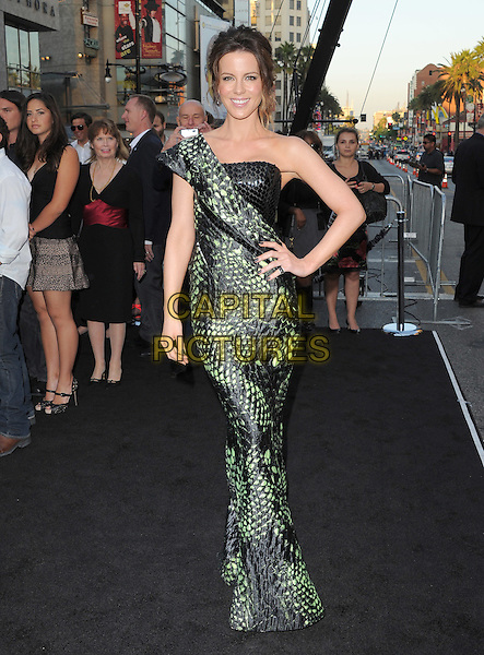 Kate Beckinsale.Premiere of 'Total Recall' held at The Grauman's Chinese Theatre in Hollywood, California, USA..August 1st, 2012.full length dress hand on hip black strapless green one shoulder snakeskin animal print paillettes   .CAP/RKE/DVS.©DVS/RockinExposures/Capital Pictures.