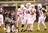 NWA Media/Michael Woods --11/01/2014-- w @NWAMICHAELW... University of Arkansas  defender Brooks Ellis (51) celebrates with his team after returning an interception in the 2nd quarter of Saturday nights game against Mississippi State at Davis Wade Stadium in Starkville, Mississippi.