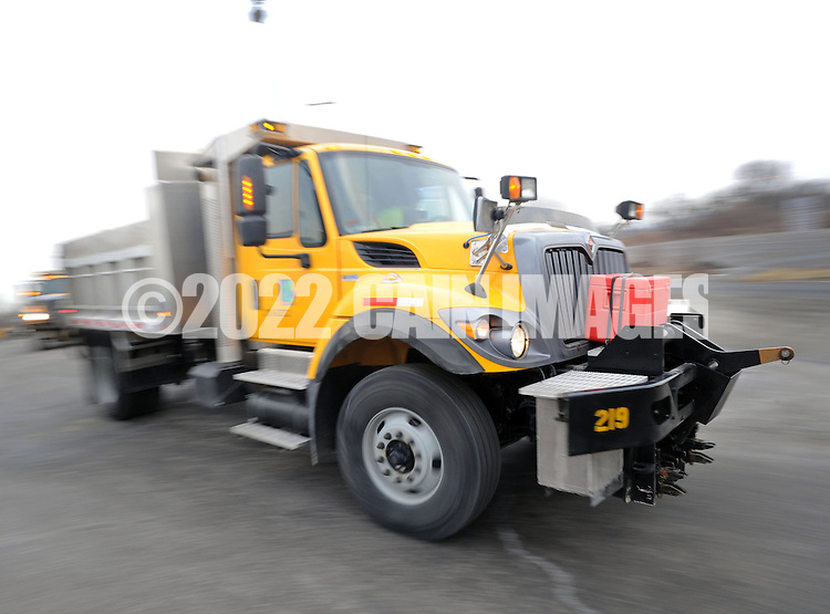 BENSALEM, PA - FEBRUARY 12: A PennDOT truck exits the Neshaminy PennDOT stockyard along with five other trucks on it's way to help the city of Boston with snow removal February 12, 2015 in Bensalem, Pennsylvania. In response to a request from Massachusetts, PennDOT and the Pennsylvania Turnpike is sending crews and equipment to assist with snow removal after repeated significant snow storms.(Photo by William Thomas Cain/Cain Images)