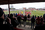 Altrincham 2 Worcester City 0, 23/03/2013. Moss Lane, Blue Square Bet North. Home team supporters react with delight in the covered terracing behind the goal as their team scores the opening goal during the second-half of the the Blue Square Bet North fixture between Altrincham (in red) and Worcester City at Moss Lane, Altrincham. The home team won the match 2-0 watched by 777 spectators on a day when most non-League football in England was cancelled due to adverse weather. Altrincham were historically one of the major English non-League teams but have never been promoted to the Football League. Photo by Colin McPherson.
