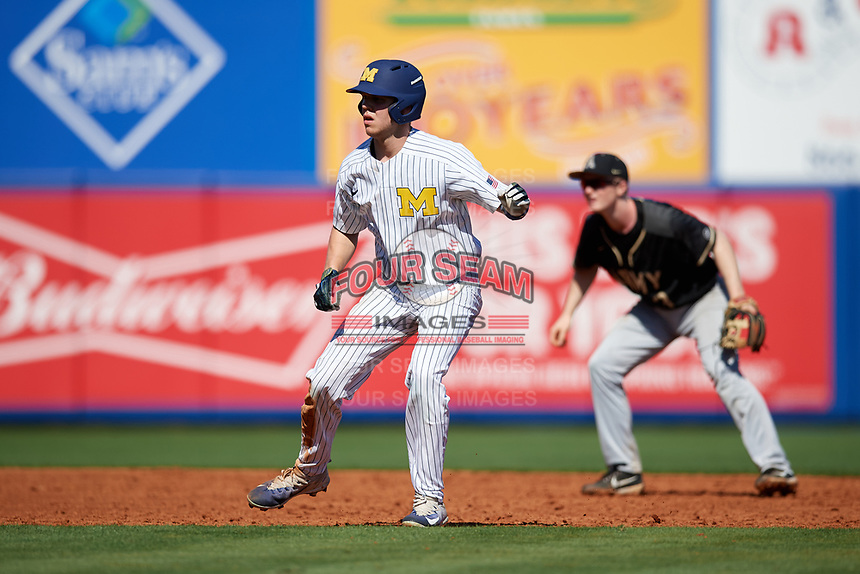 Michigan Wolverines designated hitter Dominic Clementi (13) leads off second base in front of shortstop Josh White (3) during a game against Army West Point on February 18, 2018 at Tradition Field in St. Lucie, Florida.  Michigan defeated Army 7-3.  (Mike Janes/Four Seam Images)