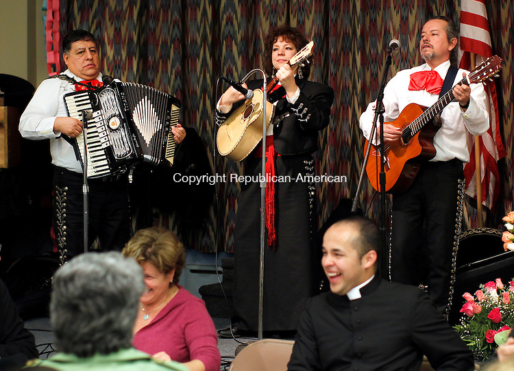 Torrington, CT- 12, December 2010-121210CM03  The Connecticut Mariachi Band, Los Trovadores de America preform Sunday afternoon at the St Peters Church hall in Torrington.  The band was apart of a Our Lady of Guadalupe, a Mexican tradition of Christianity celebrating the image of La Virgin Moren (the dark Virgin). Christopher Massa Republican-American
