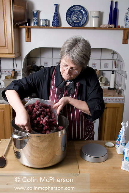 Farmer's wife Barbara Bulmer making jam at Kenyon Hall Farm at Croft near Warrington, pictured as part of the Cheshire Food Trail. The farm has been in  the family for at least 500 years and is planning to expand its successful farm shop and pick-your-own operations. The farm produces its own jams and preserves using its own fruit.