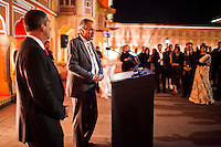 Greg Johnson (center), polo team captain of the Western Australian Polo Team and team member Nick Bowen (left) give a speech together before a violin recital at the OzFest Gala Dinner in the Jaipur City Palace, in Rajasthan, India on 10 January 2013. Photo by Suzanne Lee