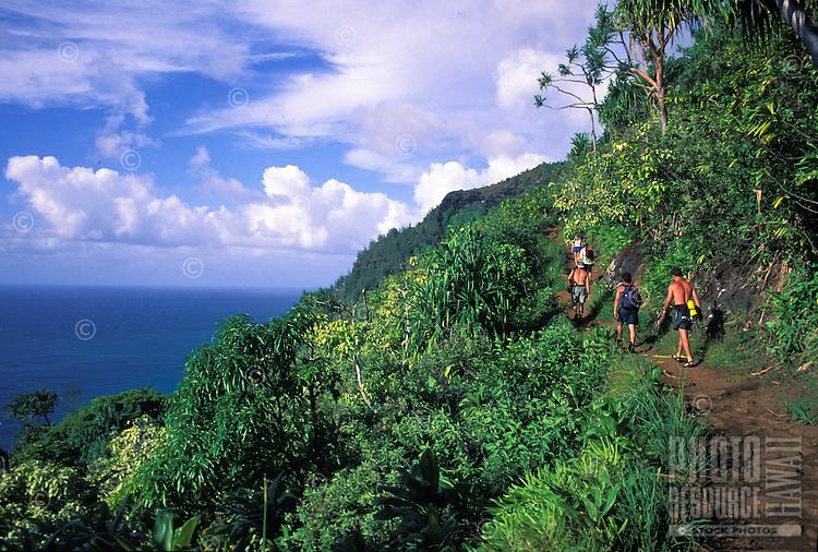Hikers returning from Hanakapiai Beach trek along the Kalalau Trail, Na Pali Coast, Kauai