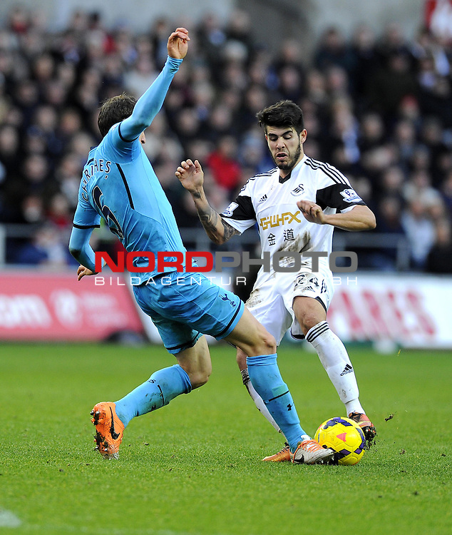 Swansea City's Alejandro Pozuelo battles for the ball with Tottenham Hotspur's Vlad Chiriches -   19/01/2014 - SPORT - FOOTBALL - Liberty Stadium - Swansea - Swansea City v Tottenham Hotspur - Barclays Premier League<br /> Foto nph / Meredith<br /> <br /> ***** OUT OF UK *****