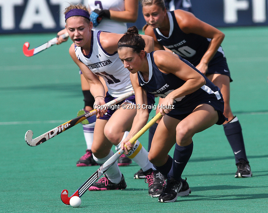 Penn State's Amanda Dinunzio (33) against   Northwestern's Kelsey Thompson (11) on Oct. 5, 2013. No. 8 Penn State defeated No. 10 Northwestern 2-0. Photo/©2013 Craig Houtz