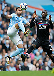 Kyle Walker of Manchester City tackles Christian Benteke of Crystal Palace during the premier league match at the Etihad Stadium, Manchester. Picture date 22nd September 2017. Picture credit should read: Simon Bellis/Sportimage