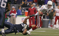 Chike Okeafor, left, sacks Arizona quarterback Josh McCown, right, on a critical third down play late in the game at Qwest Field in Seattle on Sunday Dec. 26, 2004. Photo by Kevin P. Casey/WireImage.com