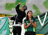 BOGOTA - COLOMBIA - 20 - 02 - 2018: Hinchas de Santiago Wanderers, animan a su equipo durante partido de vuelta entre Independiente Santa Fe (COL) y Santiago Wanderers (CHL), de la fase 3 llave 1, por la Copa Conmebol Libertadores 2018, jugado en el estadio Nemesio Camcho El Campin de la ciudad de Bogota. / Fans of Santiago Wanderers, cheer for their team during a match for the second leg between Independiente Santa Fe (COL) and Santiago Wanderers (CHL), of the 3rd phase key 1, for the Copa Conmebol Libertadores 2018 at the Nemesio Camacho El Campin Stadium in Bogota city. Photo: VizzorImage  / Luis Ramirez / Staff.