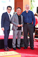 HOLLYWOOD, CA - APRIL 12: Ben Mankiewicz, Billy Crystal, Rob Reiner, at 2019 10th Annual TCM Classic Film Festival - Hand and Footprint Ceremony: Billy Crystal at the TCL Chinese Theatre IMAX on April 12, 2019. <br /> CAP/MPI/FS<br /> ©FS/MPI/Capital Pictures