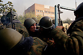 Moscow, Russia.October 4, 1993..Russian troops take up positions at the Mir Hotel on Novy Arbat Street, across the street from the US Embassy, surrounding the Parliament building in hopes of removing hundreds of well armed anti-Yeltsin demonstrators held up inside. ..Russian soldiers fire at will at anti-Yeltsin demonstartors.