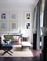 The light-filled living room is decorated in a palette that weaves Mediterranean colours through the design