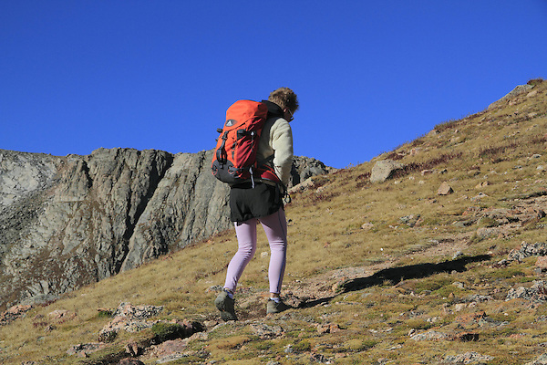 Solo Caucasian person hiking towards the summit of Mount Evans (14250 feet) in the Rocky Mountains west of Denver, Colorado.