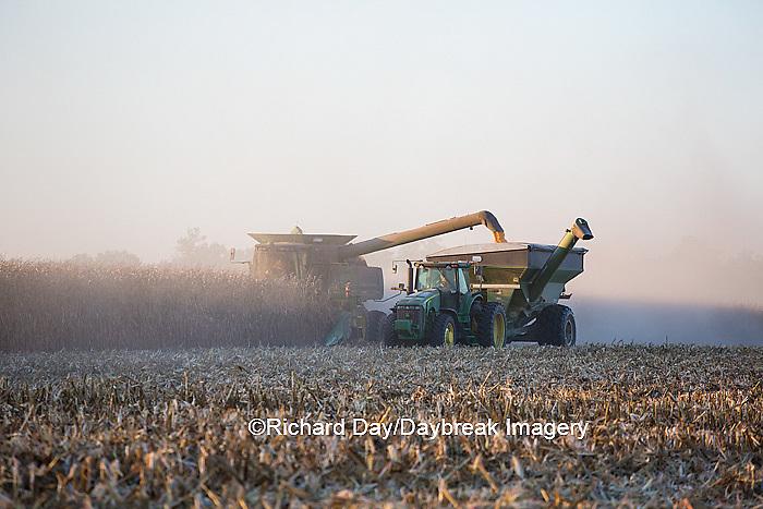63801-06613 John Deere combine harvesting corn while unloading corn into wagon, Marion Co., IL