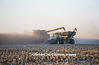 63801-06613 John Deere combine harvesting corn while unloading corn into wagon, Marion Co., IL