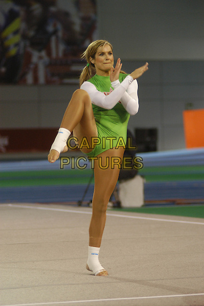 KATY HILL.The Games - Channel 4.April 12th, 2004.full length gymnastic routine green leotard funny.www.capitalpictures.com.sales@capitalpictures.com.©Capital Pictures