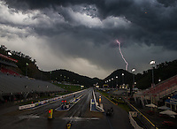 Jun 21, 2015; Bristol, TN, USA; Lightning strikes as it rains following the NHRA Thunder Valley Nationals at Bristol Dragway. Mandatory Credit: Mark J. Rebilas-USA TODAY Sports