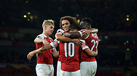 Mesut Özil of Arsenal celebrates his goal with Mattéo Guendouzi of Arsenal and teammates making it 4-0 during the UEFA Europa League match group between Arsenal and Vorskla Poltava at the Emirates Stadium, London, England on 20 September 2018. Photo by Andrew Aleks / PRiME Media Images.