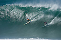 Kelly Slater (USA) and Grant Twiggy Baker (ZAF) during the Quiksilver Eddie Aikau at Waimea Bay on the Northshore of Oahu in Hawaii