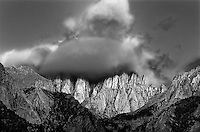 711700067BW sunrise lights up a cloud covered mount whitney the tallest point in the continental united states in eastern sierras of the alabama hills in california
