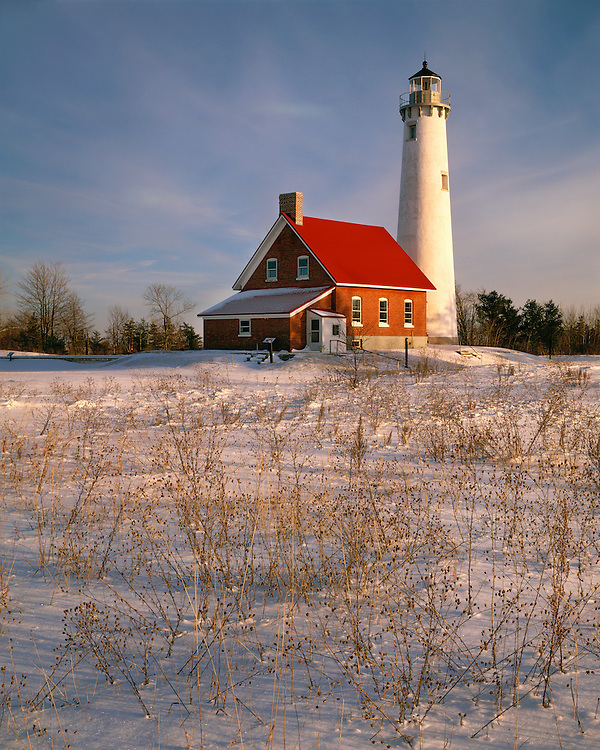 Winter evening light on Tawas Point Lighthouse on Lake Huron; Tawas Point State Park; Iosco County, MI