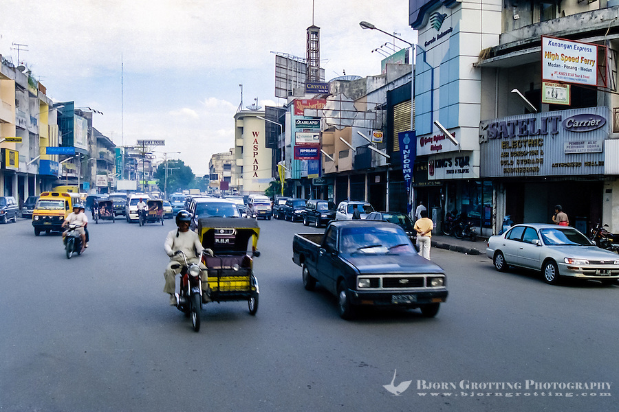 Indonesia, Sumatra. Medan. City center, the traffic is dense and noisy and the air thick of pollution.