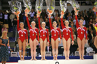 Oct 18, 2006; Aarhus, Denmark; Team USA celebrates winning silver in women's team final competition at 2006 World Championships Artistic Gymnastics.