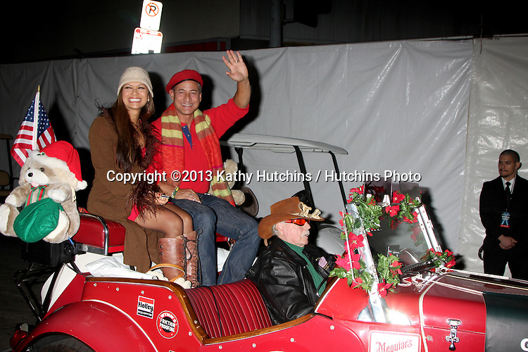 LOS ANGELES - DEC 1:  Nia Peeples, Greg Louganis at the 2013 Hollywood Christmas Parade at Hollywood & Highland on December 1, 2013 in Los Angeles, CA