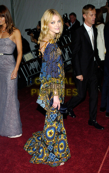 "JESSICA STAM .2007 Metropolitan Museum of Art Costume Institute Gala celebrating ""Poiret: King of Fashion"" exibition at the Metropolitan Museum of Art, New York City, New York, USA..May 7th, 2007.full length yellow blue gold tassels pattern print dress black clutch purse .CAP/ADM/BL.©Bill Lyons/AdMedia/Capital Pictures *** Local Caption ***"