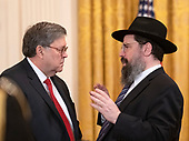 United States Attorney General William P. Barr, left, and Rabbi Levi Shemtov, Executive Vice President of American Friends of Lubavitch (Chabad) prior to the arrival of United States President Donald J. Trump who is hosting the 2019 Prison Reform Summit and First Step Act Celebration in the East Room of the White House in Washington, DC on Monday, April 1, 2019.<br /> Credit: Ron Sachs / CNP