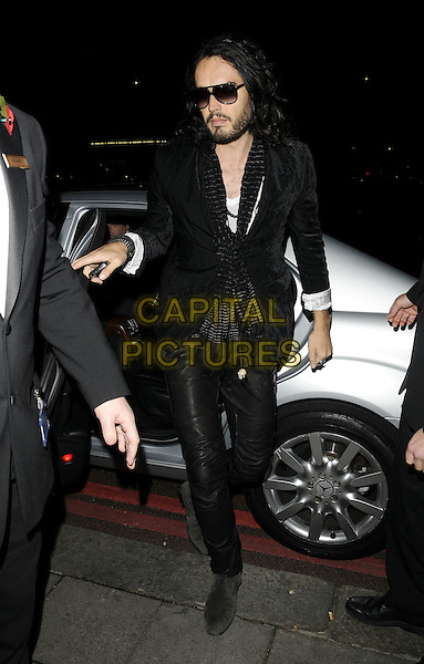 RUSSELL BRAND .at The Music Industry Trusts' Awards 2009, Grosvenor House Hotel, Park Lane, London, 2nd November 2009..full length black sunglasses jacket getting out of car arriving leather suede trousers scarf .CAP/CAN.©Can Nguyen/Capital Pictures.