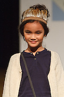 Model walks runway in an outfit by Mini-A-Ture Copenhagen, during the petitePARADE Children's Club fashion show at the Jacob Javits Center in New York City, on January 9, 2016.