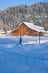 Idaho, Dalton Gardens, Coeur d' Alene. A vintage barn in a snow covered landscape.