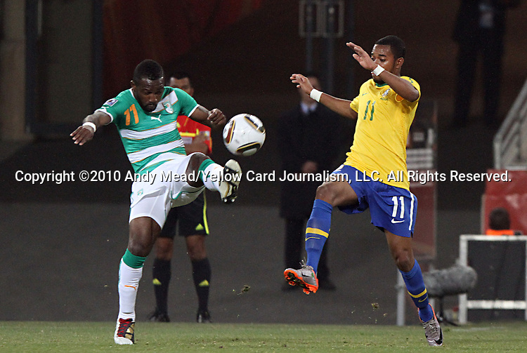 20 JUN 2010:  Siaka Tiene (CIV) beats Robinho (BRA)(11) to a loose ball.  The Brazil National Team led the C'ote d'Ivoire National Team 1-0 at the end of the first half at Soccer City Stadium in Johannesburg, South Africa in a 2010 FIFA World Cup Group G match.