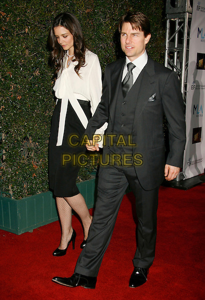 KATIE HOLMES & TOM CRUISE.Mentor LA's Promise Gala Honoring Tom Cruise held at 20th Century Fox Studios, Century City, California, USA,.22nd March 2007..full length married couple husband wife white shirt top black skirt suit fishnet tights high waisted holding hands.CAP/ADM/RE.©Russ Elliot/AdMedia/Capital Pictures.