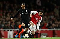 28th November 2019; Emirates Stadium, London, England; UEFA Europa League Football, Arsenal versus Frankfurt; Gabriel Martinelli of Arsenal fouls Filip Kostic of Eintracht Frankfurt - Editorial Use