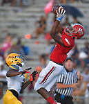Homewood-Flossmoor wide receiver Isaiah Stanback (right) catches a pass as Lutheran South's Jordan Smith watches in first half action at the Gateway Scholars Football Classic that was held at East St. Louis Senior High School on Saturday September 1, 2018.<br /> Tim Vizer/Special to STLhighschoolsports.com