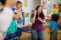 Lora Reyes is a licensed family childcare educator in Westfield, Mass., where she operates the daycare Lora's Little Ones out of her home on Thurs., June 2, 2016. Here she leads the kids in a bubble blowing and dancing activity. Today she was in charge of 7 children, aged 14 months to 5 years old, handling meals, playtime, and educational activities throughout the day, starting about 7am and going until 4:30pm. She uses the Mother Goose Time curriculum throughout the day. Reyes is currently pursuing an undergraduate degree in Psychology at Holyoke Community College. She started 2 years ago after earning a Child Development Associate certification.
