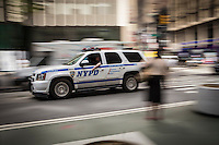 A New York Police Department car drives through the New York City borough of Manhattan, NY, Monday May 12, 2014.