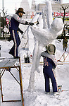 A snow sculpture team from the United States use ice picks, chisels and hatchets to turn blocks of frozen snow into detailed scupltures.These are not traditional Frosty the Snowmen, but huge carved and chiseled Samurai Warriors, Buddhists gods, historical heroes of fairy tales and Walt Disney characters. Some stand as big as buildings. Chiseled out of tons of packed snow, the sculptures are the pride and job of the residents of Sapporo, Japan, who hosts the world famous Ice and Snow Sculpture Festival for five days in early February.Themes of the sculptures are picked from Kabuki stages, historical characters or fairy tales. (Jim Bryant Photo).....