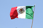 22 JUN 2010: Fans fly a Mexico flag on an improvised flagpole, pregame. The Mexico National Team played the Uruguay National Team at Royal Bafokeng Stadium in Rustenburg, South Africa in a 2010 FIFA World Cup Group A match.