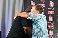 August 9, 2017: Vince Wilfork (left) hugs New England Patriots head coach Bill Belichick (right) at a press conference to announce the retirement of Wilfork held at the Optum Field Lounge, in Gillette Stadium, in Foxborough, Mass.
