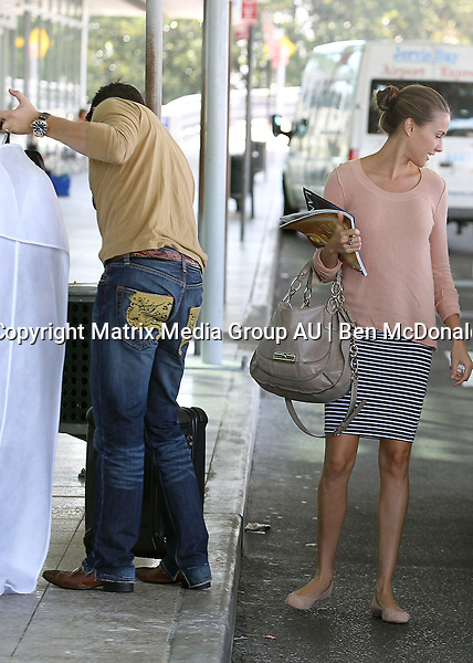 13 MARCH 2013 SYDNEY AUSTRALIA<br /> <br /> Expectant parents Rachael Finch and husband Michael Miziner pictured leaving home and at Sydney Domestic Airport.